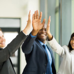 33190745 - happy business team giving high five in office